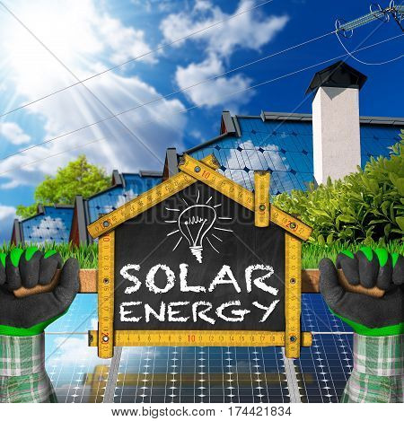 Hands with work gloves holding a wooden ruler in the shape of house with text Solar Energy. Concept of ecological house project
