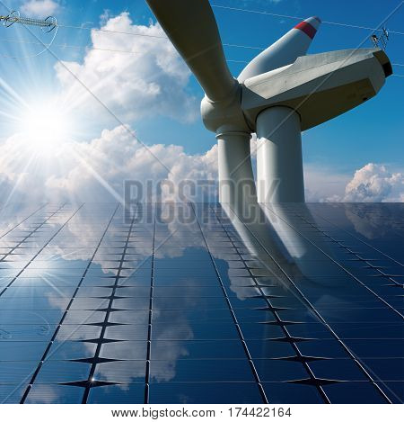 Solar panels with a wind turbine and a power line on a blue sky with clouds and sun rays. Solar and wind energy