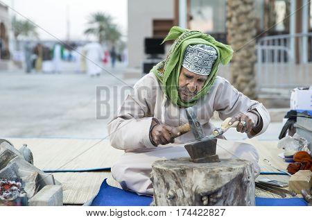 Muscat Oman February 4th 2017: old omani man making metal tools