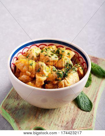 Braised chicken fillet casserole in a bowl