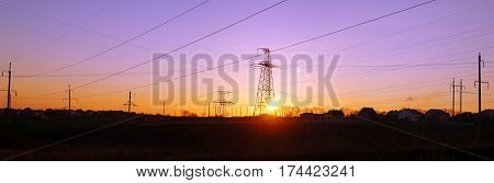 Panorama of high voltage distribution power lines pylon at sunset (ukraine oblenergo)