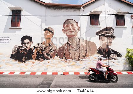 PHUKET THAILAND MARCH 4 2017: Portraits of the King of Thailand grafiti on a wall in the old town of Phuket.