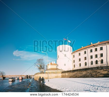 Latvia. Riga Castle, Famous Historical Cultural Medieval Landmark Of Late Classicism And Official President Residence On Bank Of Daugava River In Sunny Winte Day With Blue Clear Sky.