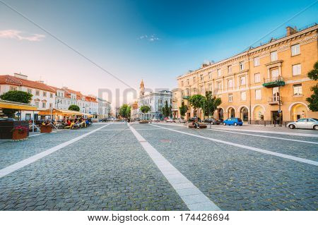 Vilnius, Lithuania. The View Of Spacious Rest Zone On Didzioji Street, The Ancient Showplace In Old Town With Outdoor Cafe In Summer Day Under Blue Sky With Clouds.