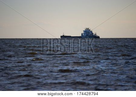 barge on the horizont. industry. copy space