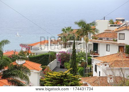Houses and gardens on hillside over the sea in Funchal on Madeira