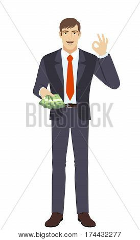 OK! Businessman with money show a okay hand sign. Full length portrait of businessman in a flat style. Vector illustration.
