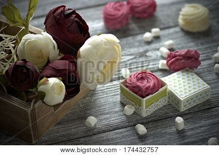 Red And White Buttercup Flowers Ranunculus White And Pink Zephyr Marshmallows On Gray Wooden Backgro