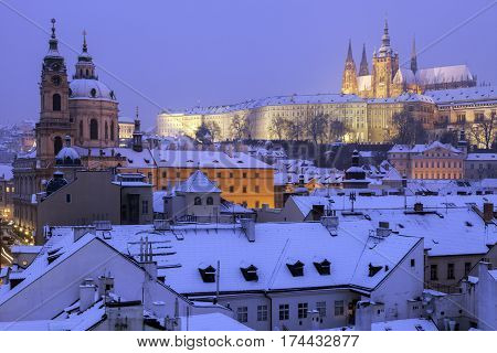 Winter in Prague - city panorama with St. Vitus Cathedral and St. Nicholas Church. Prague Bohemia Czech Republic.