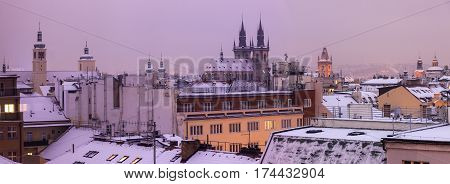 Winter in Prague - city panorama with Tyn Cathedral and Clock Tower. Prague Bohemia Czech Republic.