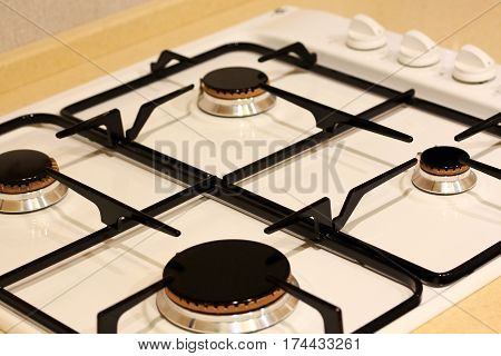 Gas stove on a kitchen countertop. Selective focus.