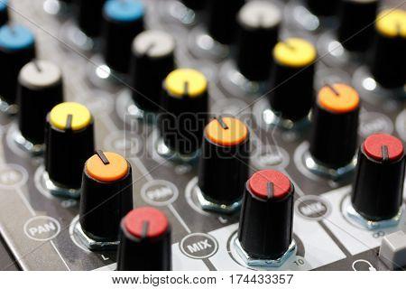 Close up of a sound mixer control panel. Selective focus.