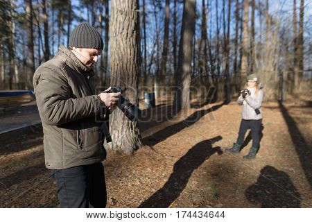 Male Photographer With The Camera On Nature.