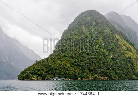 Mitre Peak in overcast weather - Milford Sound on the South Island of New Zealand
