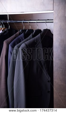 Row of men's suits hanging. Suits for business