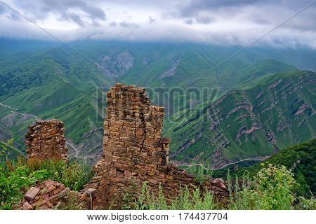 Abandoned village Gamsutl in Dagestan. Scenic landscape with ruins of lost city in mountains