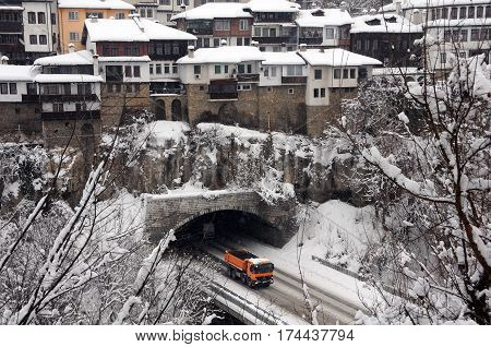 VELIKO TARNOVO BULGARIA - JANUARY 19 2017: Yellow truck comes out of the vehicular tunnel