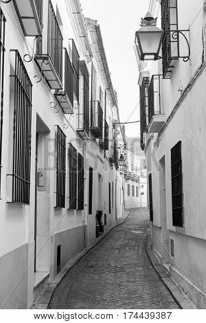 Cordoba (Andalucia Spain): old typical street in the Juderia. Black and white