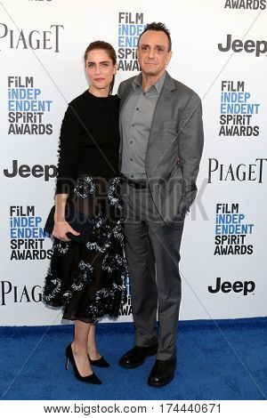 LOS ANGELES - FEB 25:  Amanda Peet, Hank Azaria_ at the 32nd Annual Film Independent Spirit Awards at Beach on February 25, 2017 in Santa Monica, CA