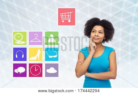 people, e-commerce and online shopping concept - happy afro american young woman over gray grid background with menu icons