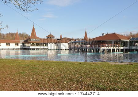 Lake Heviz with buildings of the famous Heviz Spa. Heviz, Hungary.