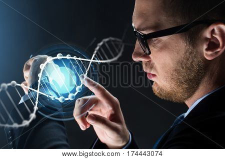 business, people and modern technology concept - close up of businessman with smart watch and dna molecule projection and dna molecule projection over black background