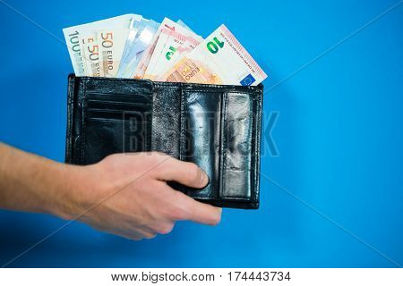 € bills in the purse money blue background