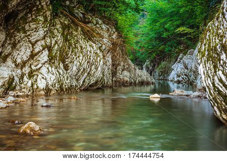 Mountain river Khosta canyon Devil's Gate in Caucasian biosphere reserve Sochi Russia. Popular mountain tourist route.