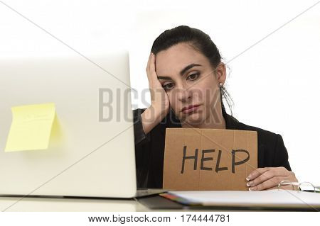 young attractive latin woman showing help sign desperate suffering stress at work while sitting at office laptop computer desk in business overwork female feeling stressed and overwhelmed