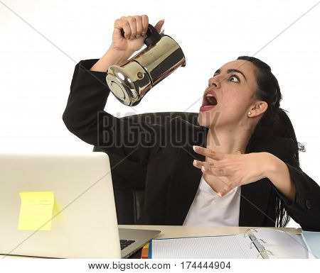 young attractive business woman at laptop computer desk drinking coffee pouring it on mouth directly from the pot excited and anxious in caffeine addiction concept isolated on white