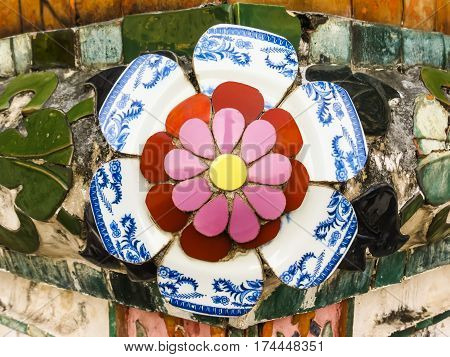 Detail of mosaic in the ancient Wat Arun Temple or Temple of Dawn. Flower made of splinters of ceramic ware. Wat Arun Temple, Bangkok, Thailand