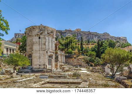 The Tower of the Winds is an octagonal Pentelic marble clocktower on the agora in Athens Greece