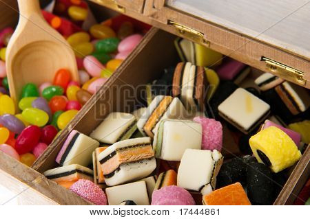 Wooden candy bar with assortment sweets isolated over white poster