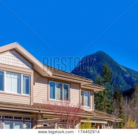 Top of a very neat and colorful home with gorgeous outdoor landscape in suburbs of Vancouver, Canada