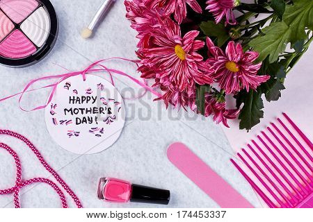 Bunch of chrysanthemums and accessories. Useful present for mother.
