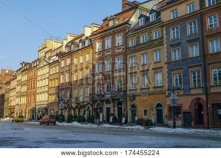 Warsaw, Poland -January 5, 2011: Houses in old town market square Warsaw Poland. Winter time with snow