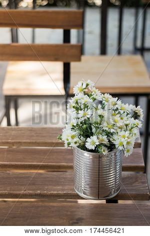 Vintage white flower pot on wooden table stock photo