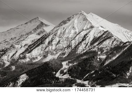 The mountain peaks of La Grande and Petite Autane covered in snow in winter. Black & White. Ecrins National Parc Champsaur Hautes Alpes French Alps. France