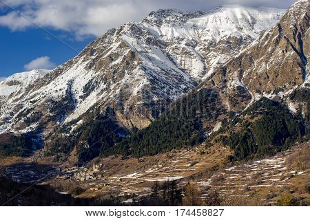 The Village of Reallon and the Roche Meane mountain peak in winter. Hautes Alpes Ecrins National Park French Alps France