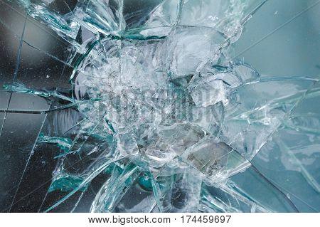 Bulletproof glass background, bullethole from the bullets, cracks and broken. Criminal concept