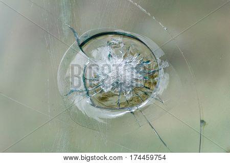 Bulletproof glass background, bullethole from the bullets, cracks and broken. Criminal concept poster