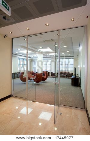 view to a meating room through glass wall
