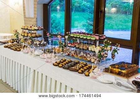Dessert table for a party. Sweet table at a wedding. Candy bar