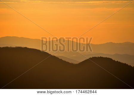 hill in the mist at dawn orange hills sunrise in mountains lines of hills