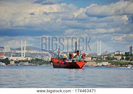 Vladivostok city in summertime golden horn bay golden bridge red ship in the roads before Vladivostok