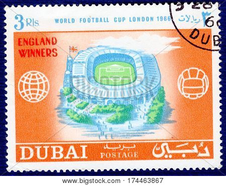 DUBAI - CIRCA 1966: Postage stamp printed in Dubai  with a picture of a stadium, with the inscription