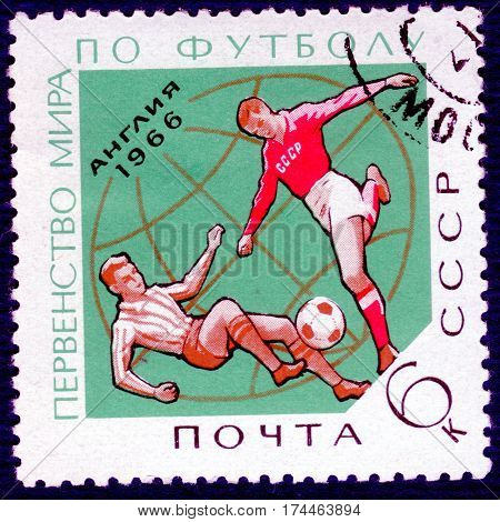 USSR - CIRCA 1966: Postage stamp printed in USSR with a picture of a football players, with the inscription