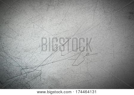 Texture of metal with long black scratches on the surface. Gray metallic horizontal background.