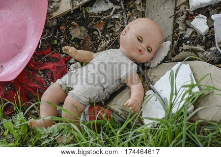 toy doll is completely left alone among the rubbish