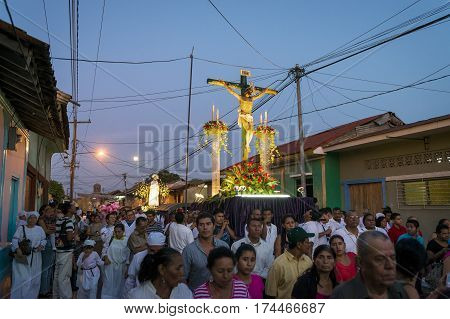 Leon Nicaragua - April 15 2014: People at night in a procession in the streets of the city of Leon in Nicaragua during the Easter celebrations